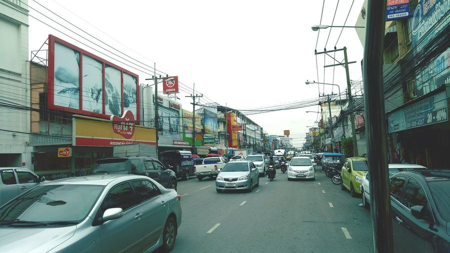 Vehicles on road along buildings