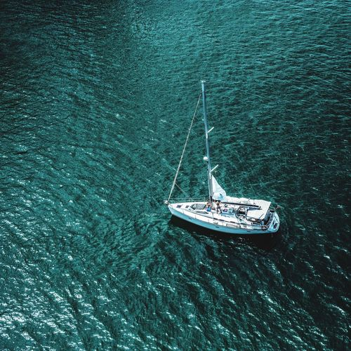 Aerial view of sailboat sailing on sea