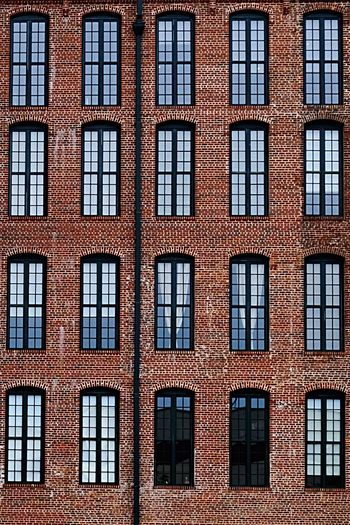 The Architect - 2017 EyeEm Awards Architecture Windows Symmetry Unsymmetrical Building Exterior Brick Brick Wall Buildings Building Outside Red Orange Behind Behind The Veils Relaxing Relaxation Relax Edit Exceptional Photography BYOPaper! Exceptional Photographs Photo Of The Day City Street