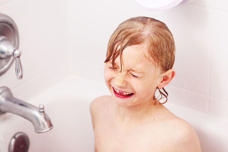 Angry Bath Time Bathroom Boys Child Childhood Crying Cute Dramatic Elementary Age Emotions Girl Headshot Home Interior Indoors  Innocence Person Portrait