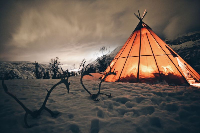 Tent in winter at night