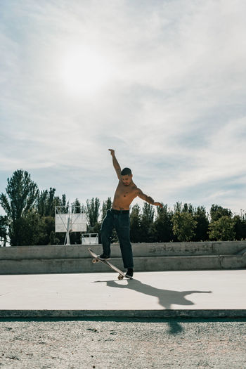 Full length of man standing on field against sky