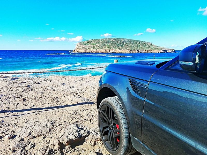 Comte Beach, Ibiza, Spain. Outdoors Car Sea Beach Water Land Rover RRsport English Car Sky