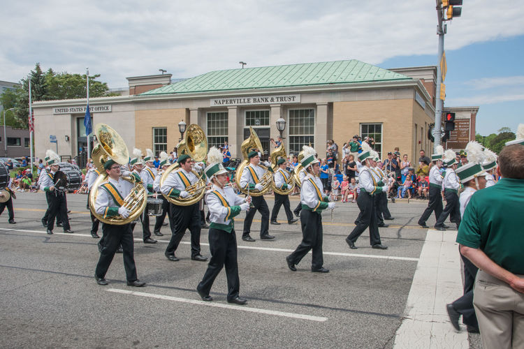 Naperville, Illinois, United States-May 29,2017: Waubonsie Valley High School marching in Memorial Day Parade with crowd in Naperville, Illinois Large Group Of People Crowd Street City March Marching Marching Band High School Students Waubonsie Valley In A Row Musician Musical Instrument Celebration Music Event Parade Performance Arts Culture And Entertainment Brass Instrument  Tuba Drum Togetherness Unity Brass
