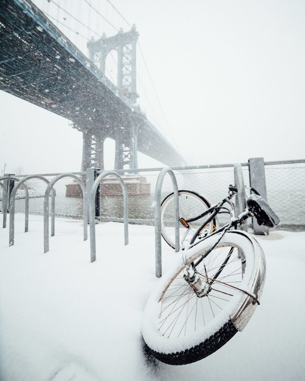 transportation, winter, snow, cold temperature, mode of transportation, architecture, bicycle, nature, built structure, bridge, day, bridge - man made structure, land vehicle, connection, no people, sky, outdoors, railing, stationary, snowing, wheel