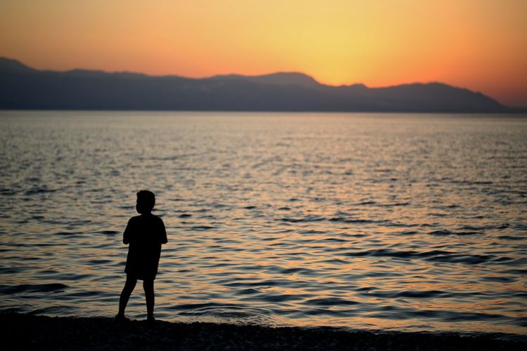 GREECE ♥♥ Loutraki Beach Beachphotography Child Greece Landscape Landscape_photography One Person Outdoors Real People Seascape Seaside Silhouette Sunset Tranquil Scene Vacation Water