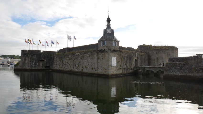 Ville close de Concarneau Architecture Cloud Water Reflections Arch Architecture Battlements Bell Tower Bridge Building Building Exterior Built Structure Citadel Clock Tower Cloud - Sky Fortified Wall Historic History Nature No People Outdoors Reflection Sky The Past Water Waterfront