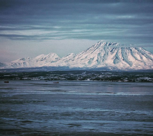 Kamchatka Russia Volcanic Landscape Volcano Avacha Glacier Landscape Cloud - Sky Outdoors Water Sea Mountain Cold Temperature Winter Far North Snow Tranquility Nature Beauty In Nature Scenics Idyllic Tourism No People Weather Vulcano