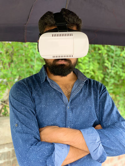 VR technology One Person Real People Front View Casual Clothing Young Men Leisure Activity Day Young Adult Lifestyles Waist Up Standing Men Beard Portrait Focus On Foreground Facial Hair Three Quarter Length Outdoors Obscured Face