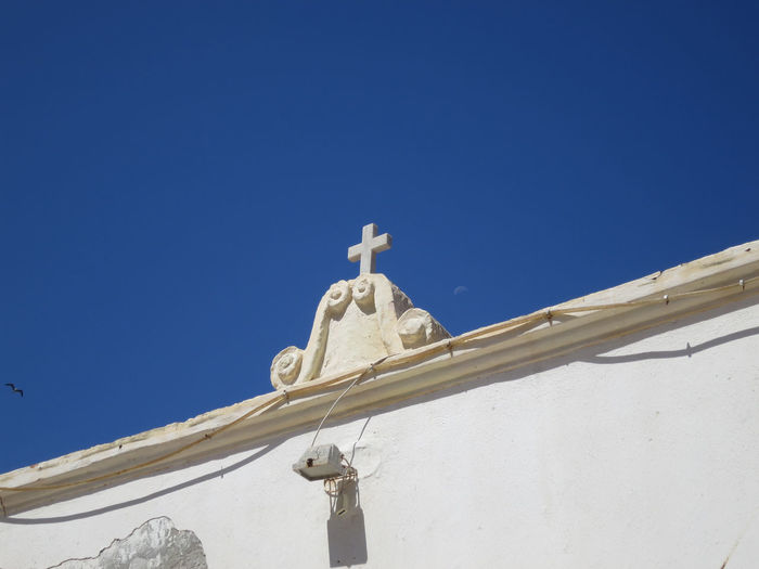 white cross Sky Low Angle View Clear Sky Blue Spirituality Religion Belief Built Structure Architecture Nature No People Sunlight Cross Day White Color Place Of Worship Building Outdoors