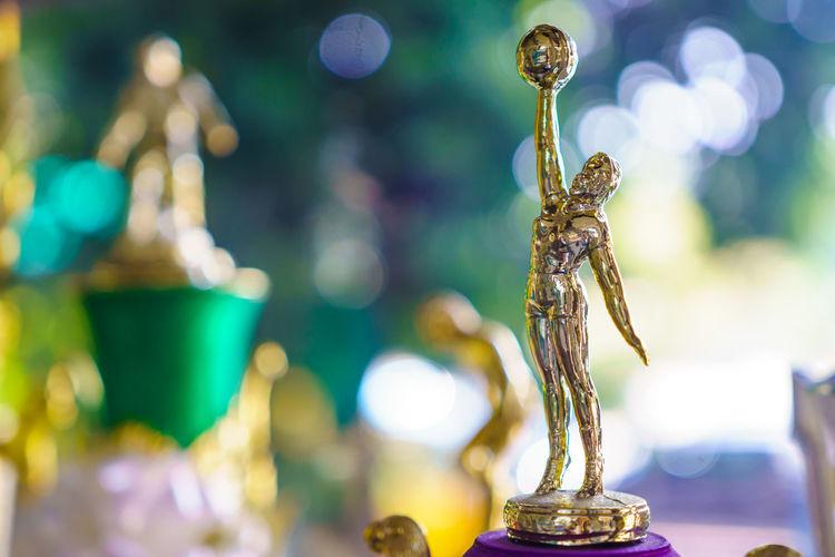 Close up of golden figurine