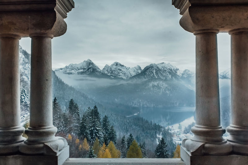 SCHWANGAU, BAVARIA, GERMANY - NOVEMBER 17, 2017: Beautiful landscape and Schwangau village and Alpsee lake seen from Neuschwanstein castle in Bavaria, Germany Mountain Cold Temperature Winter Scenics - Nature Beauty In Nature Snow Nature Mountain Range Architecture Architectural Column Cloud - Sky Tree Fog No People Sky Built Structure Tranquil Scene Tranquility Day Outdoors Snowcapped Mountain Cultures Germany Bavaria Neuschwanstein My Best Photo