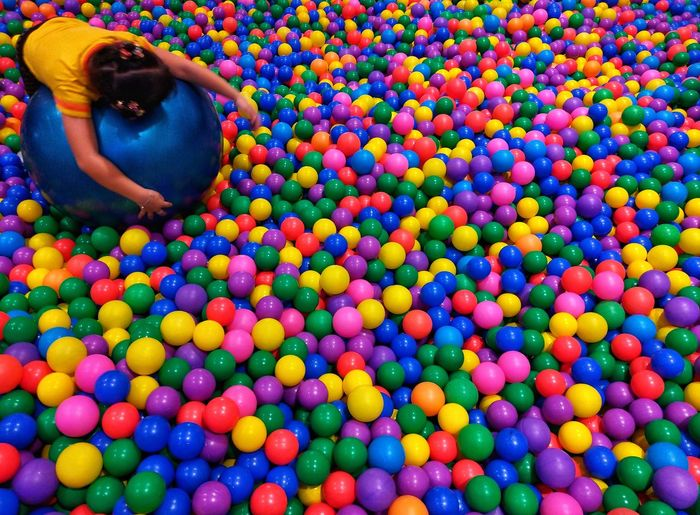 High angle view of woman with multi colored balls