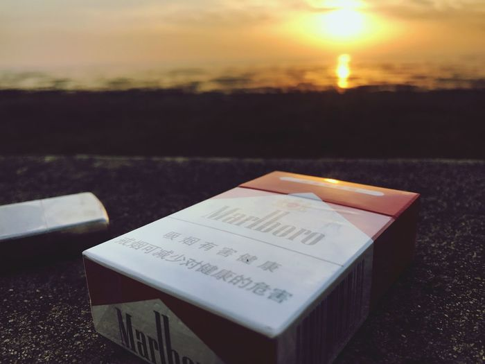 Marlboro Red Sunset Lifestyles Outdoors Mo ring Nature One Person No People Zippo🔥 Smiling City Sunup Morning ☀️