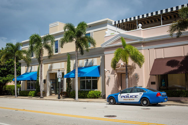Police and palms Building Exterior Architecture Built Structure Car Motor Vehicle Transportation Mode Of Transportation Building Tree Land Vehicle City Plant Road Street Nature No People Residential District House Sunlight Outdoors Luxury Police Car Palm Tree