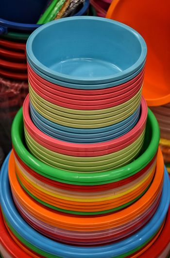 High angle view of multi colored plastic containers at market stall