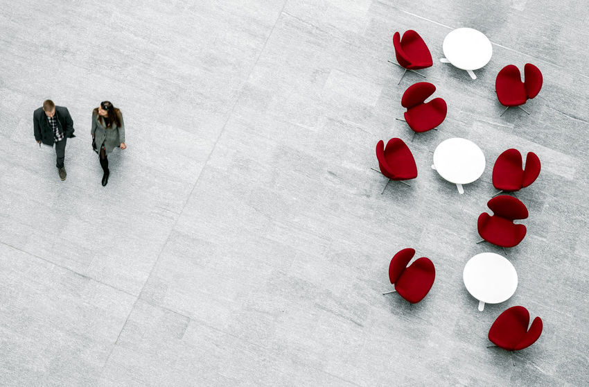 Pair of people walking in business center lobby with modern furniture The Architect - 2018 EyeEm Awards Red High Angle View People Day Lobby Waiting Area Armchair Business Center Office Building Chairs And Tables Chairs Furnitures Interior Indoors  Pair Man And Woman Abstract Lost In The Landscape The Week On EyeEm EyeEmReady