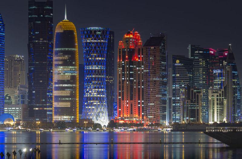 Downtown cityscape at night. illuminated city at waterfront. doha