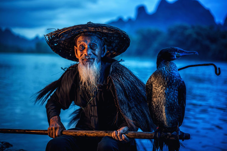 Cormorant fisherman in Traditional showing of his birds on Li river near Xingping, Guangxi province, China. Cormorant  Fisherman Traditional Birds River Xingping Guangxi Province China Guangxi Culture Capture Tomorrow
