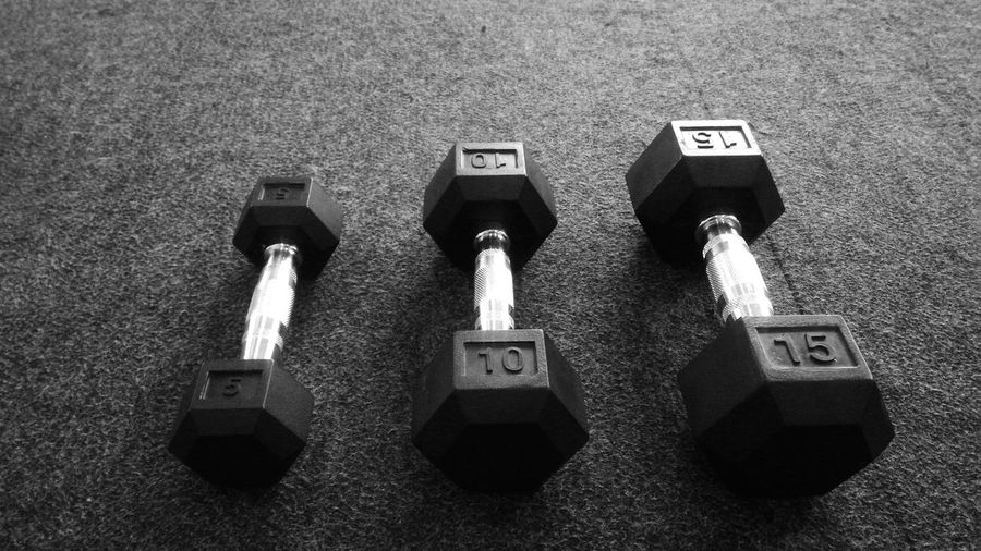 High Angle View Of Dumbbells On Floor