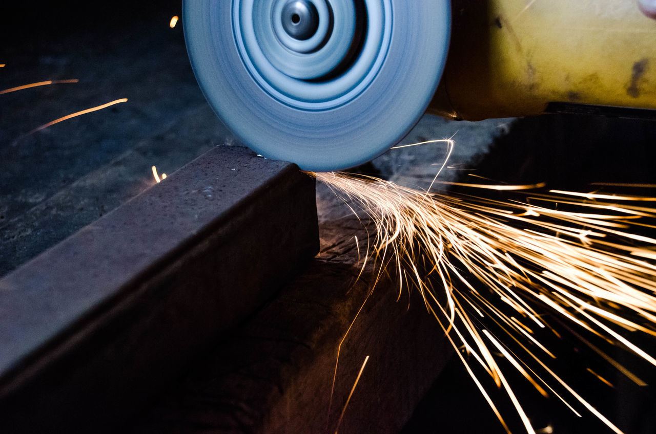 indoors, industry, metal industry, cutting, manufacturing equipment, heat - temperature, factory, workshop, grinding, occupation, working, no people, technology, serrated, close-up, day