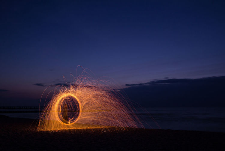 Man Playing With Wire Wool At Night