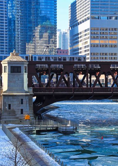 Chicago el train speeding over a frozen Chicago River with chunks of ice. Chicago River Chicago Riverwalk Chicago Architecture Chicago El Chicago Loop Elevated Track Ice Architecture Blue Bridge - Man Made Structure Bridgehouse Building Exterior Built Structure City Connection Day Frozen Water Icy Modern Moving Train Nature Outdoors Skyscraper Transportation Water