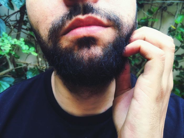 Midsection Of Bearded Mid Adult Man Against Plants