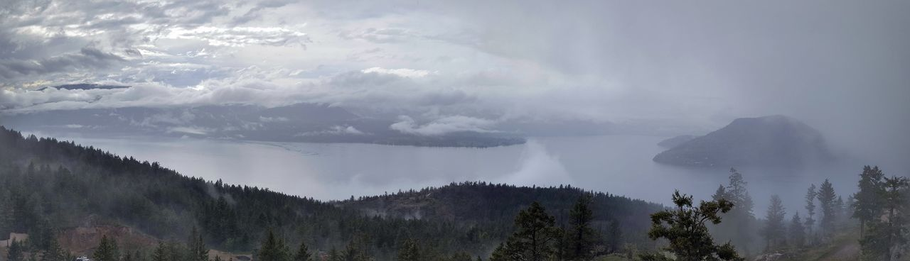 Misty evening vista of Okanagan Lake, BC Canada Beauty In Nature Blue British Columbia Canada Day Fog Forest Gray Landscape Mist Mountain Mystical Nature No People Okanagan Outdoors Power In Nature Scenics Sky Tranquility Tree Zen