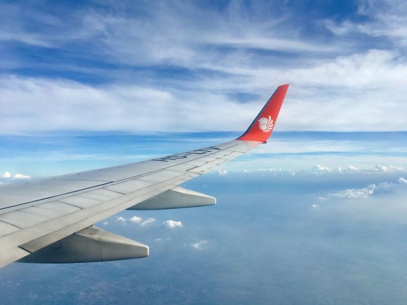 Airplane Wing Airplane Air Vehicle Sky Cloud - Sky Flying Transportation Aircraft Wing Travel No People Day Blue