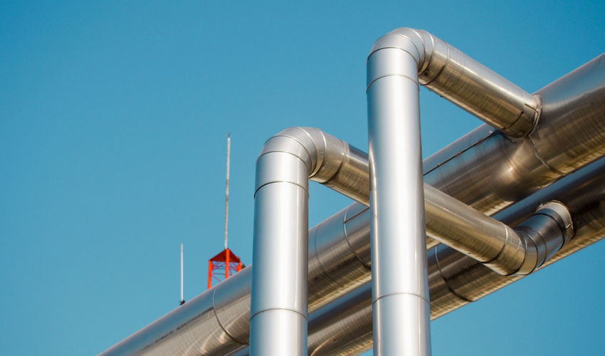 Low Angle View Of Pipes Against Sky