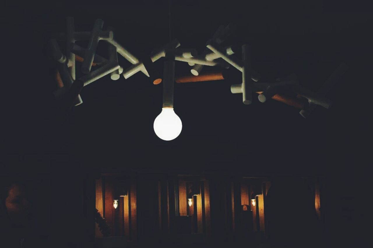 illuminated, lighting equipment, indoors, dark, no people, hanging, night, architecture, light, built structure, light bulb, in a row, ceiling, low angle view, technology, electricity, glowing, pendant light, copy space, electric lamp