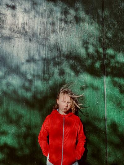 Portrait of girl standing in rain