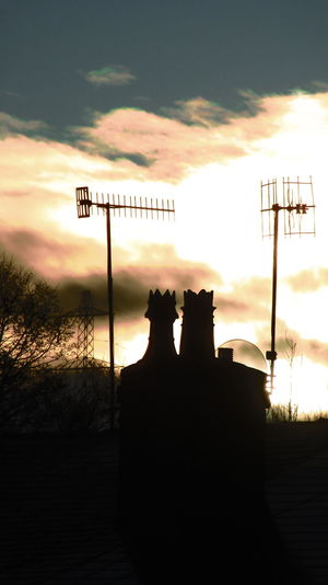 shades of coronation Street , sunrise out sude my house Silhouette Cloud - Sky No People Sky Communication Outdoors Road Sign Day Nature Tranquility Eyeem Market The Week On EyeEm Sheffieldissuper Chimney Tops King&queen Television Aerial