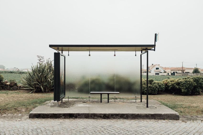 LOST IN GALICIA 🚌 Lostingalicia Threeweeksgalicia Bus Stop Sky Architecture Nature Built Structure Plant Day Clear Sky Seat Copy Space No People Empty Tree Absence Bench Outdoors Building Exterior Park Footpath Field Land