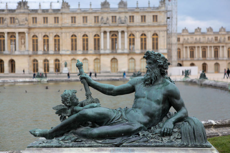 Ancient Civilization Architecture Art Art And Craft Bronze Statue Building Exterior Chaiselounge City Life Culture Famous Place Fountain Garden Historic History Human Representation Illuminated Incidental People Large Group Of People Night Sculpture Statue Town Square Versailles Versailles Gardens Zeus