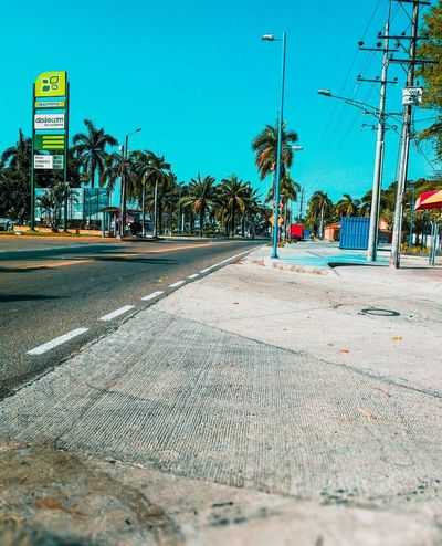 BELLEZA #photography #PhotographerLife Photos #huaweip10 Sky Tree Beach Land Nature Transportation Water Tropical Climate No People Palm Tree Sign Plant Sunlight Outdoors Street Road Day Blue Sand City