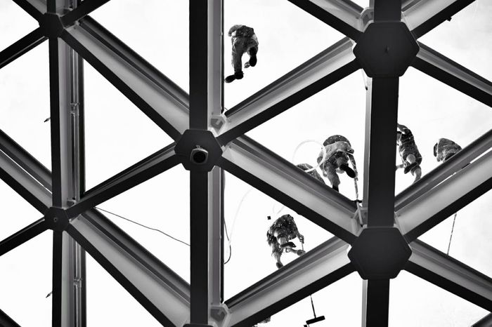 Men cleaning the glass rooftop Student Architectural Column City Window Washer