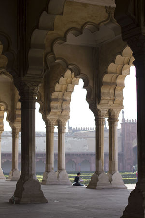 Agra Fort Arch Architectural Column Architecture Built Structure Day History One Person People Real People Red Fort Sitting Tourism Travel Destinations