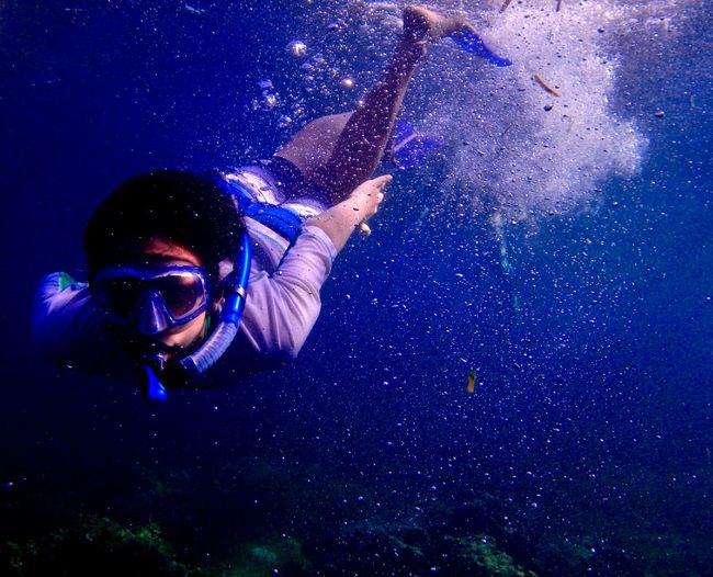 Woman Snorkeling Undersea