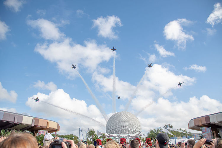 US Navy Blue Angels performing a fly past in Orlando, Epcot Sky Cloud - Sky Architecture Flying Building Exterior Real People Day Group Of People Built Structure Large Group Of People Nature Crowd Vertebrate Men Women Adult Low Angle View Bird US Navy US Navy Blue Angels Epcot