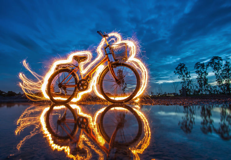 Light Painting Over Bicycle By Lake
