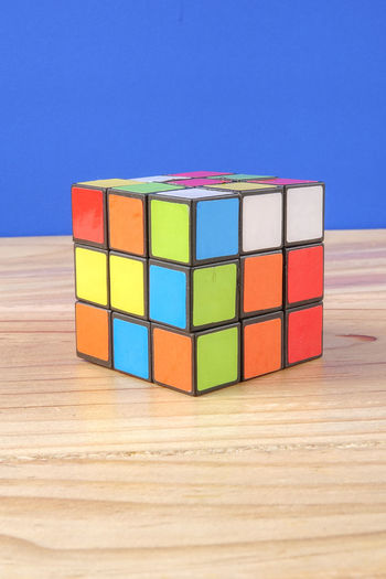 RUBIK'S CUBE , CREATIVITY TOY Creativity Rubik Cube Blue Choice Close-up Copy Space Cube Shape Geometric Shape Group Of Objects Indoors  Intelligence Large Group Of Objects Multi Colored No People Rubik Shape Still Life Table Toy Toy Block Variation Wood - Material