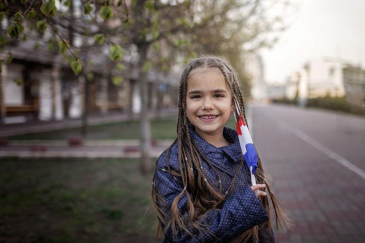 Portrait of girl standing on street