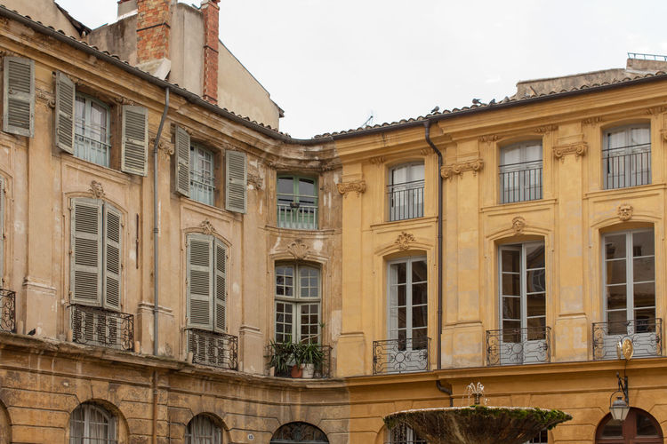 High section of buildings at Place d'Albertas, Aix-en-Provence Arch Architecture Building Exterior Built Structure City Clear Sky Day Exterior Façade High Section Historic History In A Row Low Angle View No People Outdoors Residential Building Sky Window