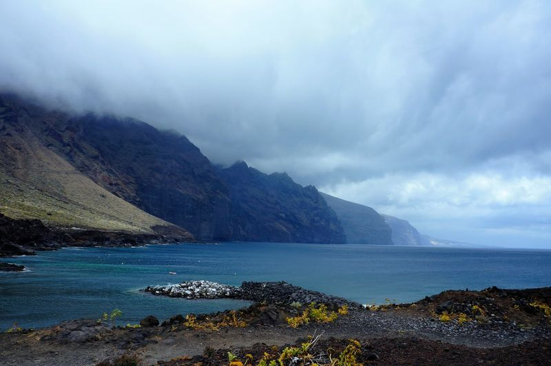 Blue Travel Travel Destinations Beach Water Mountain Sea Outdoors Landscape Scenics Cloud - Sky Storm No People Sky Nature Eco Tourism Day Tenerife Beauty In Nature Nature Tranquility Vacations