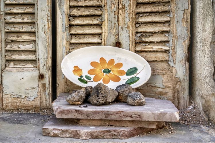 Various flowers on stone wall
