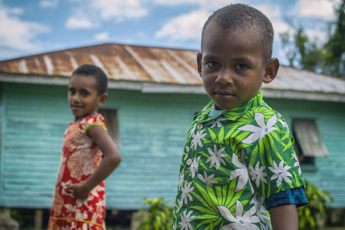Child Day Fiji Holding Island Life Looking At Camera Outdoors People Portrait Standing Village Village Life Water