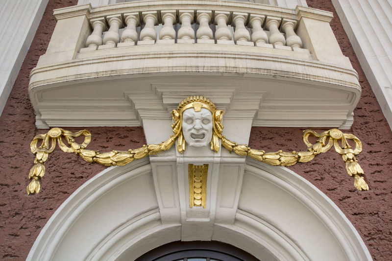 A theatrical mask, an architectural element of Ivan Vazov National Theater in Sofia, Bulgaria Architecture Day Gilded Gold Gold Colored Ivan Vazov National Theatre Lion - Feline Low Angle View No People Religion Royalty Sofia, Bulgaria Statue