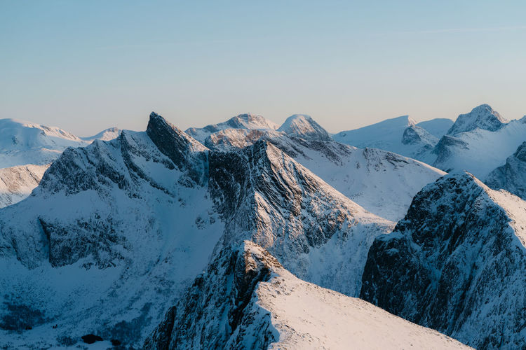 sharp edges of Senja. find more travel inspiration at http://www.instagram.com/simonmigaj Norway Adventure Travel Photography Destination Climb Mountaineering Hiking Blue Mountain Snow Mountain Range Winter Landscape Snowcapped Mountain Outdoors Nature Travel Scenics Mountain Peak Travel Destinations Day Cold Temperature Beauty In Nature No People